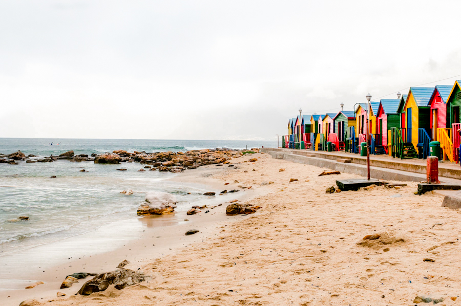 42314920 - multicoloured beach huts at st. james beach on a rainy morning